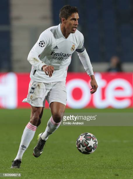 Raphael Varane of Real Madrid in action during the UEFA Champions League Round of 16 match between Atalanta and Real Madrid at Gewiss Stadium on...