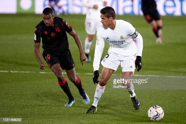 Raphael Varane of Real Madrid in action with Alexander Isak of Real Sociedad during the Spanish Liga Santander match between Real Madrid and Real...