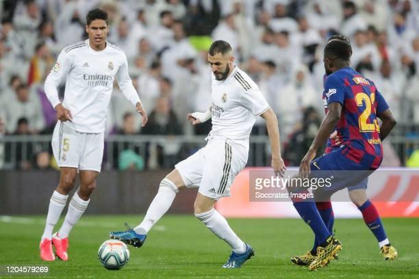 Raphael Varane of Real Madrid Karim Benzema of Real Madrid Samuel Umtiti of FC Barcelona during the La Liga Santander match between Real Madrid v FC...