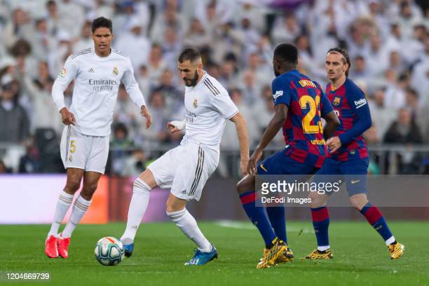 Raphael Varane of Real Madrid Karim Benzema of Real Madrid Samuel Umtiti of FC Barcelona and Antoine Griezmann of FC Barcelona battle for the ball...