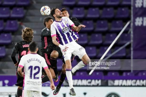Raphael Varane of Real Madrid, Kenan Kodro of Real Valladolid, Casemiro of Real Madrid during the La Liga Santander match between Real Valladolid v...
