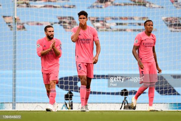Raphael Varane of Real Madrid looks dejected after his team concede during the UEFA Champions League round of 16 second leg match between Manchester...