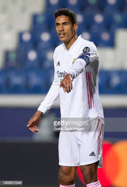 Raphael Varane of Real Madrid reacts during the UEFA Champions League Round of 16 match between Atalanta and Real Madrid at Gewiss Stadium on...