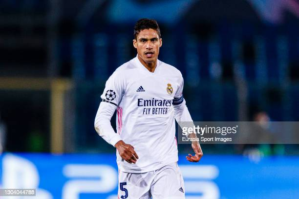 Raphael Varane of Real Madrid runs in the field during the UEFA Champions League Round of 16 match between Atalanta and Real Madrid at Gewiss Stadium...
