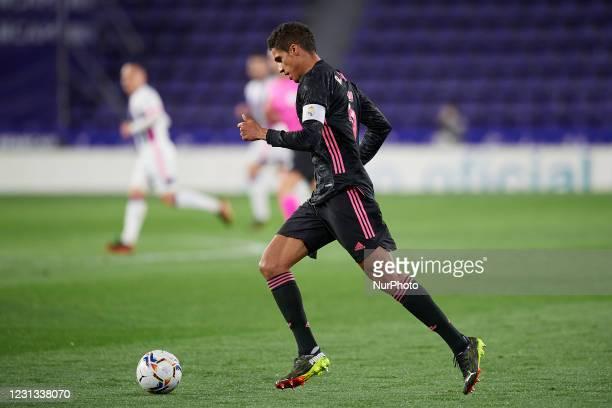 Raphael Varane of Real Madrid runs with the ball during the La Liga Santander match between Real Valladolid CF and Real Madrid at Estadio Municipal...