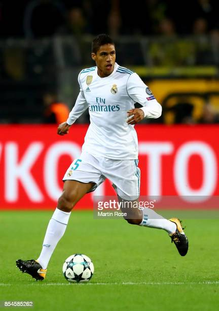 Raphael Varane of Real Madrid runs with the ball during the UEFA Champions League group H match between Borussia Dortmund and Real Madrid at Signal...