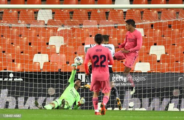 Raphael Varane of Real Madrid scores an own goal during the La Liga Santander match between Valencia CF and Real Madrid at Estadio Mestalla on...