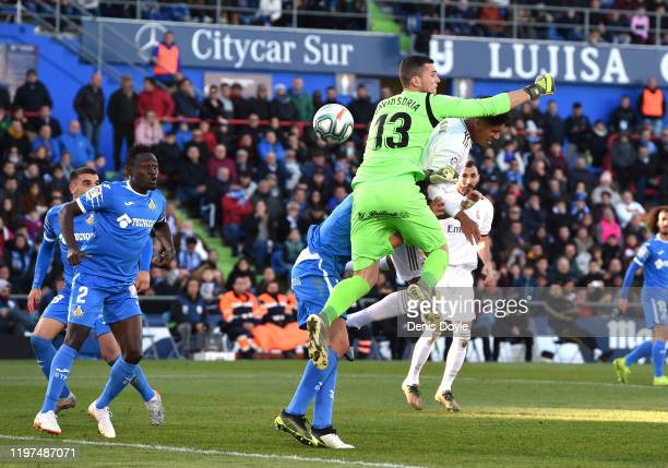Raphael Varane of Real Madrid scores his team's first goal during the La Liga match between Getafe CF and Real Madrid CF at Coliseum Alfonso Perez on...