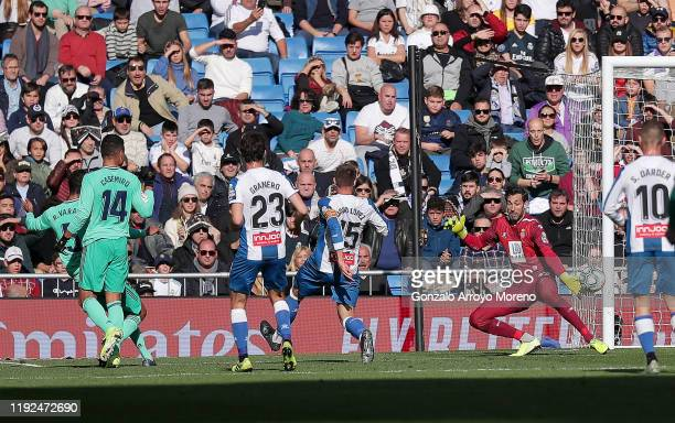 Raphael Varane of Real Madrid scores his team's first goal past Diego Lopez of Espanyol during the Liga match between Real Madrid CF and RCD Espanyol...