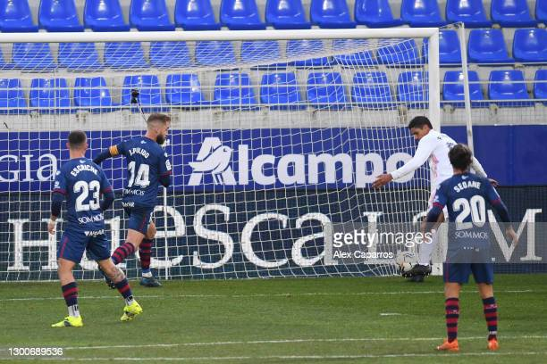 Raphael Varane of Real Madrid scores his team's second goal during the La Liga Santander match between SD Huesca and Real Madrid at Estadio El...