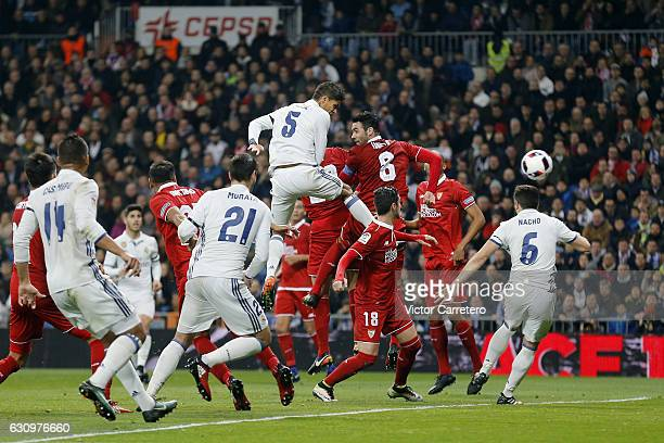 Raphael Varane of Real Madrid scores his team's second goal during the Copa del Rey round of 16 first leg match between Real Madrid CF and Sevilla at...