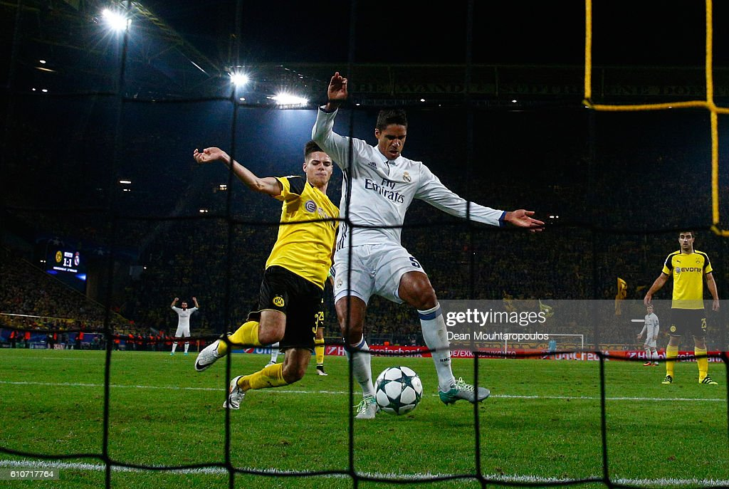 Raphael Varane of Real Madrid scores their second goal during the UEFA Champions League Group F match between Borussia Dortmund and Real Madrid CF at Signal Iduna Park on September 27, 2016 in Dortmund, North Rhine-Westphalia.