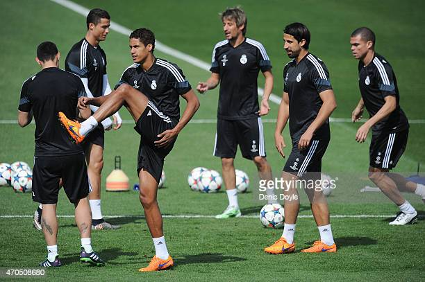 Raphael Varane of Real Madrid warms up with Cristiano Ronaldo Fabio Coentrao Sami Khedira and Pepe during the Real Madrid training at Valdebebas...