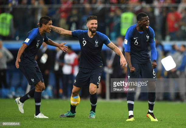 Raphael Varane Olivier Giroud and Paul Pogba of France celebrate following their sides victory in the 2018 FIFA World Cup Russia Semi Final match...