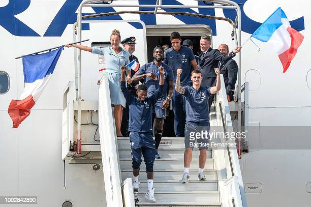 Raphael Varane Samuel Umtiti Ousmane Dembele and Antoine Griezmann of France during the arrival at Airport Roissy Charles de Gaulle on July 16 2018...