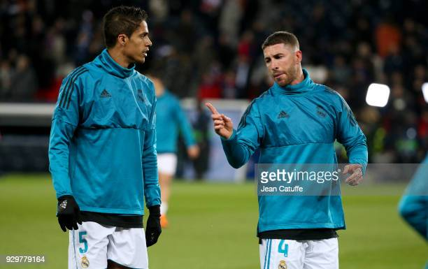 Raphael Varane Sergio Ramos of Real Madrid warm up prior to the UEFA Champions League Round of 16 Second Leg match between Paris SaintGermain and...