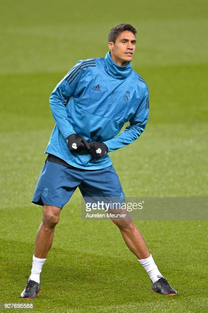 Raphael Varane warms up during a Real Madrid training session ahead of the Champion's League match against Paris SaintGermain at Parc des Princes on...