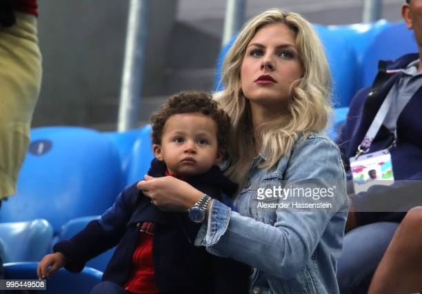 Raphael Varane's wife Camille Tytgat and son Ruben attend the 2018 FIFA World Cup Russia Semi Final match between Belgium and France at Saint...
