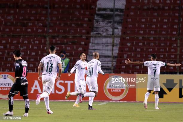 Raphael Veiga of Palmeiras celebrates with teammates after scoring the first goal of his team during a match between Independiente del Valle and...
