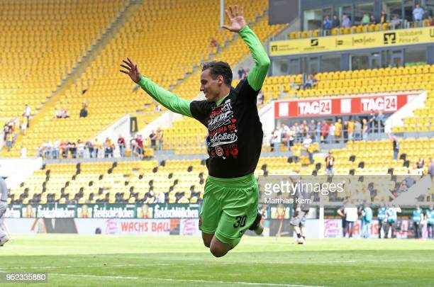 Raphael Wolf of Duesseldorf jubilates after moving up into the Bundesliga after the Second Bundesliga match between SG Dynamo Dresden and Fortuna...