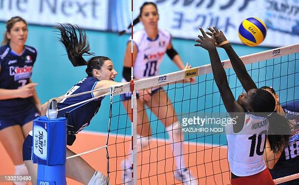 Raphaela Folie of Italy spikes the ball over Noel Murambi of Kenya during a match of the World Cup women's volleyball tournament in Tokyo on November...