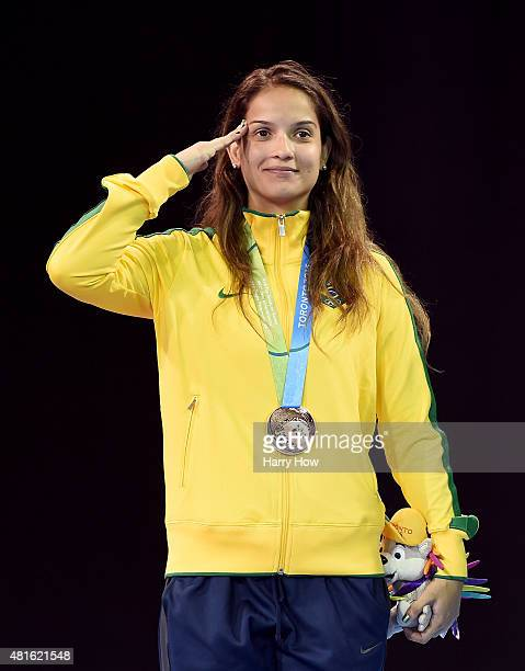 Raphaella Galacho of Brazil celebrates her bronze medal in the women's 67kg plus taekwando final during the 2015 Pan Am Games at the Mississauga...