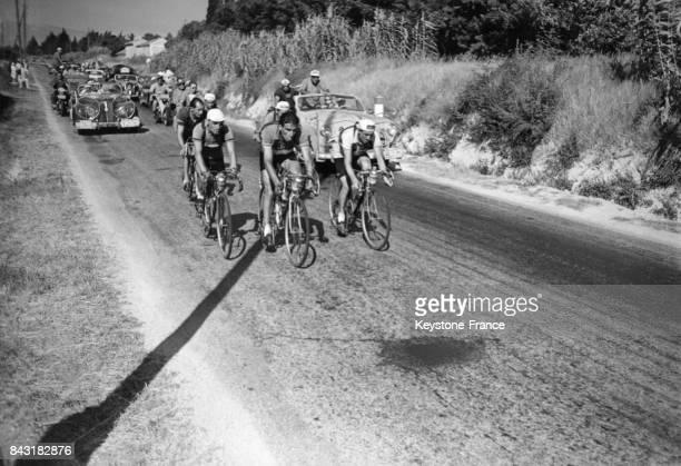 Raphaël Géminiani Stan Ockers et Gino Bartali lors de la 14ème étape du Tour de France en France en 1958