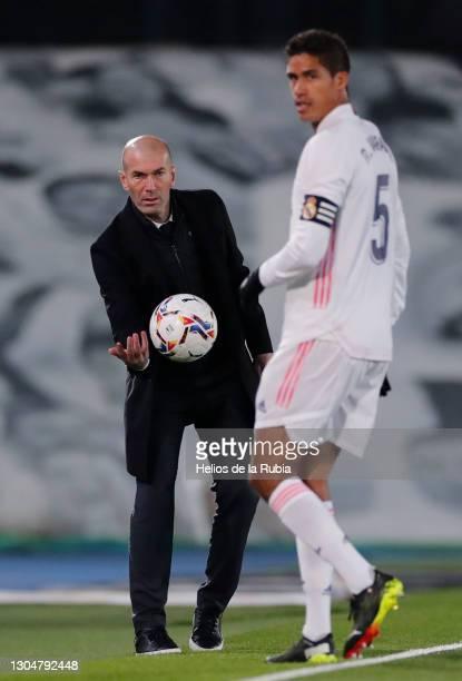 Raphaël Varane and Zinedine Zidane during the La Liga Santander match between Real Madrid and Real Sociedad at Estadio Santiago Bernabeu on March 01,...