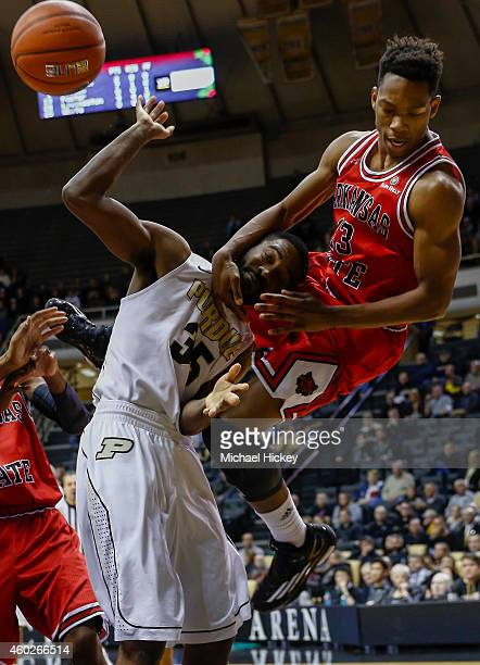 Rapheal Davis of the Purdue Boilermakers is fouled by CJ Foster of the Arkansas State Red Wolves at Mackey Arena on December 10 2014 in West...