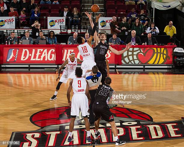 Raphiael Putney of the Rio Grande Valley Vipers and Tibor Pleiss of the Idaho Stampede go up for the opening tip off at CenturyLink Arena on February...