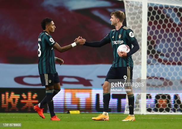 Raphinha of Leeds United and Patrick Bamford of Leeds United celebrate following their sides victory in the Premier League match between Aston Villa...