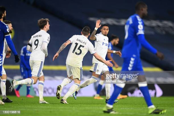 Raphinha of Leeds United celebrates with Stuart Dallas after scoring his team's first goal during the Premier League match between Leeds United and...