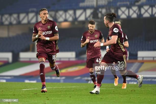 Raphinha of Leeds United celebrates with teammate Jack Harrison after scoring his team's first goal during the Premier League match between Everton...