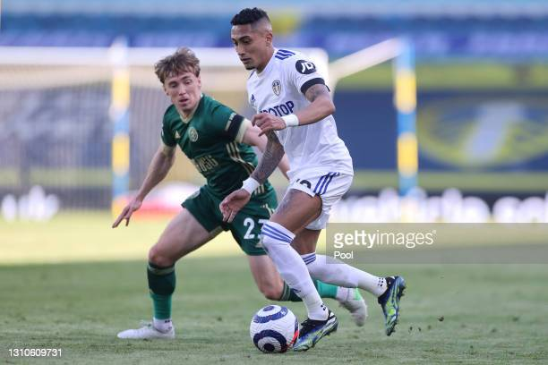 Raphinha of Leeds United runs with the ball under pressure from Ben Osborn of Sheffield United during the Premier League match between Leeds United...