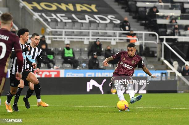 Raphinha of Leeds United scores their team's first goal during the Premier League match between Newcastle United and Leeds United at St. James Park...