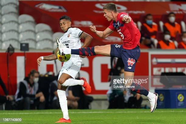 Raphinha of Rennes fights for the ball with Sven Botman of Lille during the Ligue 1 match between Lille OSC and Stade Rennes at Stade Pierre Mauroy...