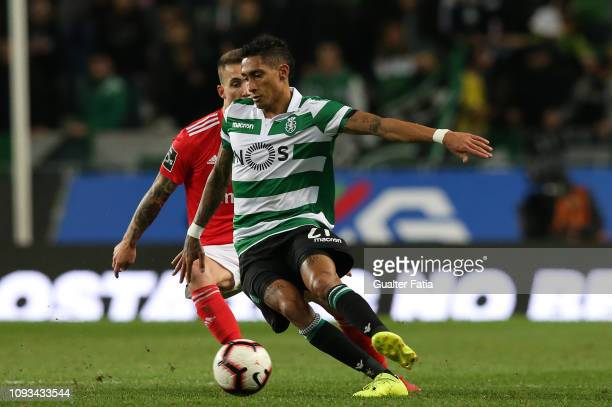 Raphinha of Sporting CP with Alex Grimaldo of SL Benfica in action during the Liga NOS match between Sporting CP and SL Benfica at Estadio Jose...