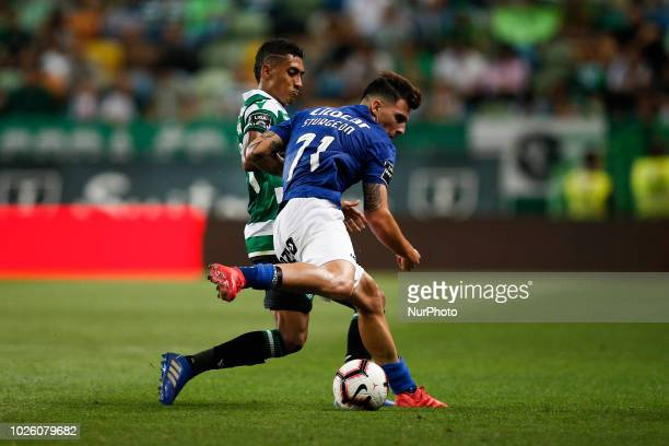 Raphinha of Sporting vies for the ball with Fabio Sturgeon of Feirense during Primeira Liga 2018/19 match between Sporting CP vs CD Feirense in...