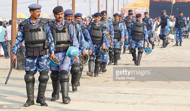 Rapid Action Force Jawans vigil near ghats on the occasion of Maghi Purnima festival last bathing day of one month Magh mela festival in Allahabad