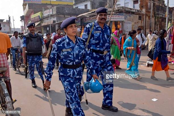 Rapid Action Force personnel patrol on a street in Ayodhya on November 8 ahead of a Supreme Court verdict on the future of a disputed religious site...
