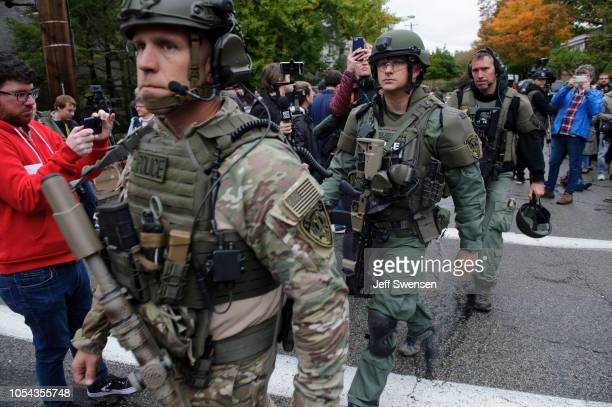 Rapid reaction SWAT members leave the scene of a mass shooting at the Tree of Life Synagogue in the Squirrel Hill neighborhood on October 27 2018 in...