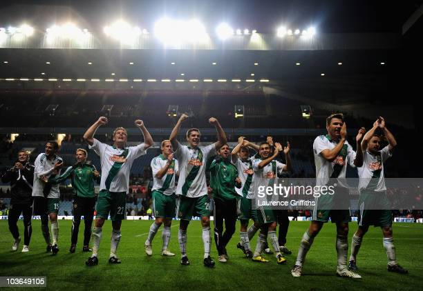 Rapid Vienna celebrate on the final whistle during the UEFA Europa League second leg match between Aston Villa and SK Rapid Vienna at Villa Park on...