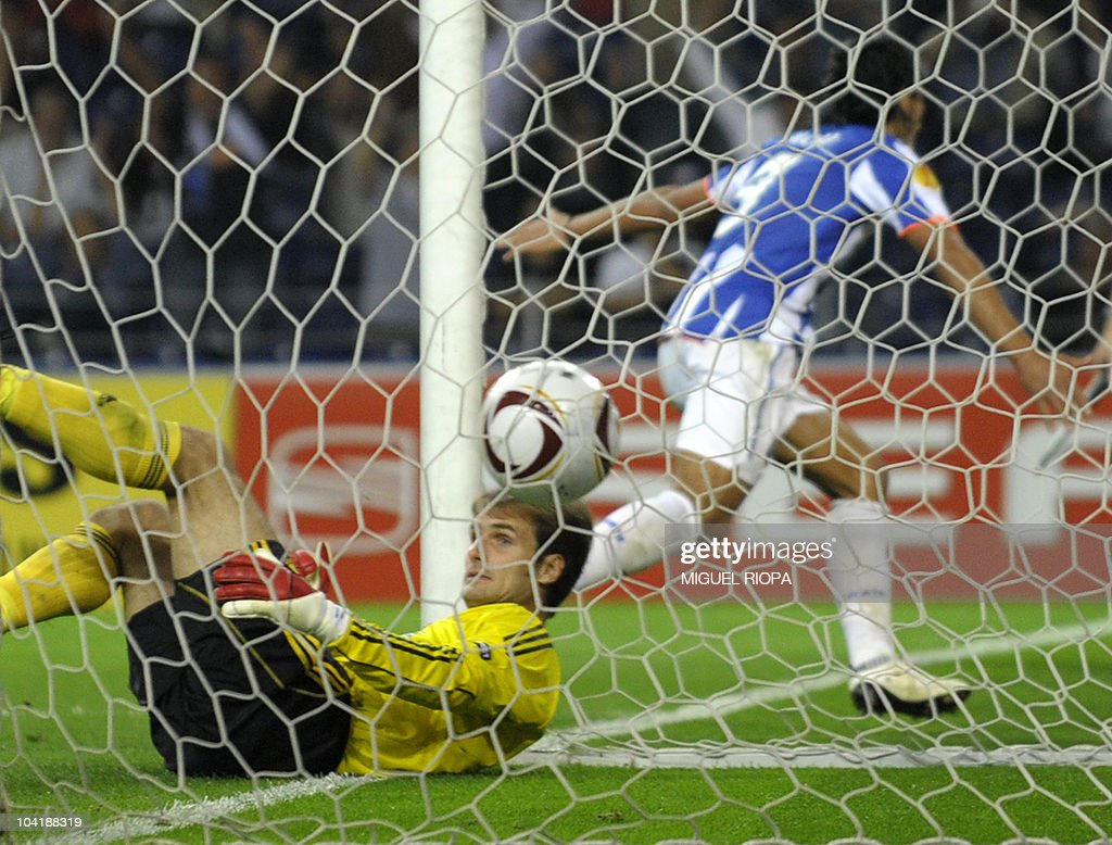 Rapid Vienna's goalkeeper Raimund Hedl (L) lies on the ground as FC Porto's forward from Colombia Radamel Falcao (R) celebrates his goal during their UEFA Europa League football match at the Dragao Stadium in Porto, on September 16, 2010. Porto won the match 3-0.