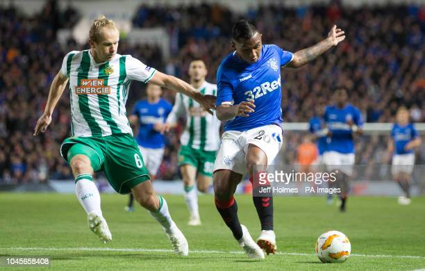 Rapid Vienna's Mario Sonnleitner and Rangers Alfredo Morelos battle for the ball during the UEFA Europa League Group G match at Ibrox Stadium Glasgow