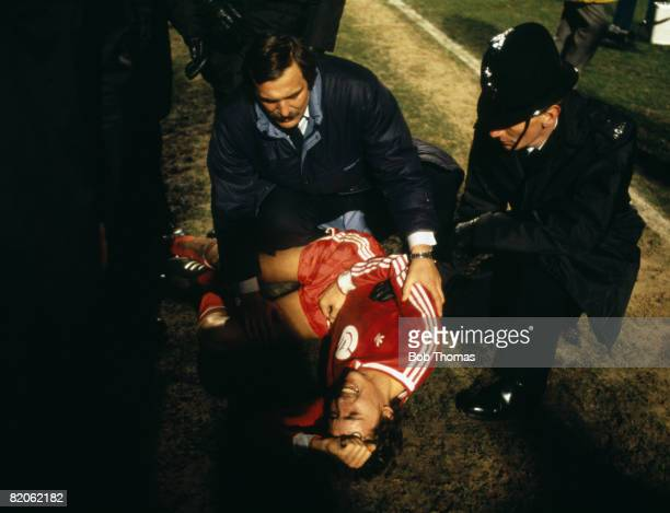 Rapid Vienna's Peter Pacult is attended by a team official and a Scottish Police officer after the Austrian was attacked at the end of their European...