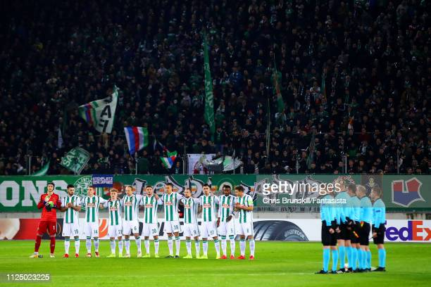Rapid Wien take part in a minute's silence in honour of Emiliano Sala ahead of the UEFA Europa League Round of 32 First Leg match between SK Rapid...