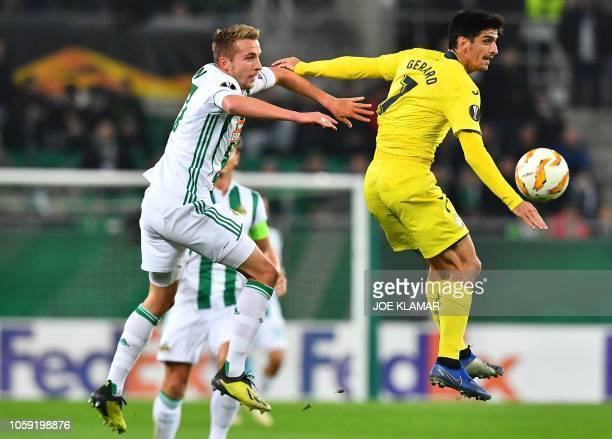Rapid Wien's Austrian defender Christopher Dibon and Villarreal's Spanish forward Gerard Moreno vie for the ball during the UEFA Europa league...