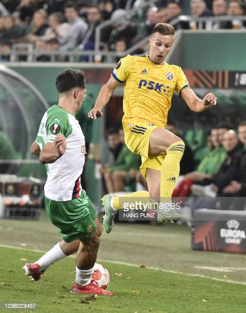 Rapid Wien's Austrian defender Leo Greiml and Dinamo Zagreb's Croatian midfielder Mislav Orsic vie for the ball during the UEFA Europa League group H...