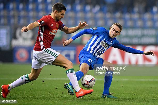 Rapid Wien's Austrian defender Thomas Schrammel vies with Genk's Belgian defender Timothy Castagne during the UEFA Europa League football match...
