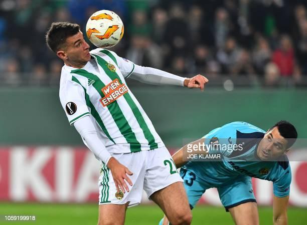 Rapid's Austrian forward Andrija Pavlovic eyes the ball as Villarreal's Spanish goalkeeper Andres Fernandez looks on during the UEFA Europa league...
